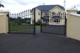 Ornate Curved Wrought Iron Entrance Gate.