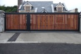 Cleanly Designed Metal Frame Gate With Teak Sheeting