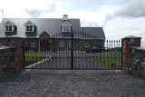 Decorative Wrought Iron galvanised and powder coated main entrance gates.