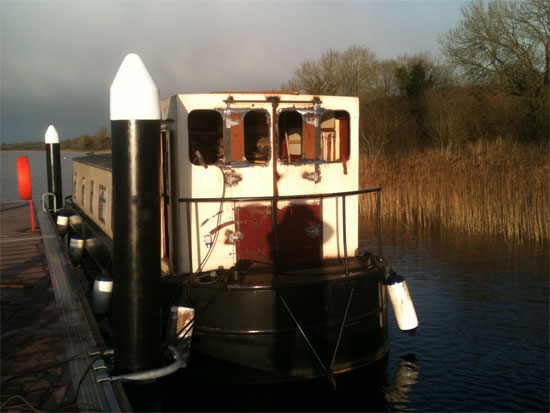 View of barge stern, new doors , windows, floor & handrail to barge.