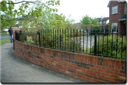 Rail fitted to a curved garden wall.