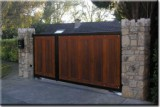 Off-centre Hardwood Automated Driveway Gates.